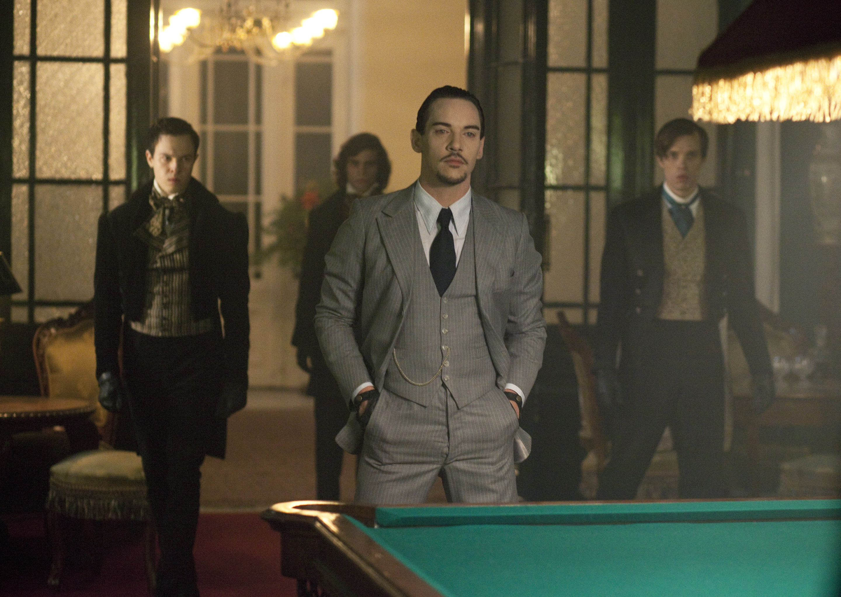 "Dracula -  Vampires and Alexander Grayson stand in a billiard room, in episode 109, ""Through A Lens Darkly"""