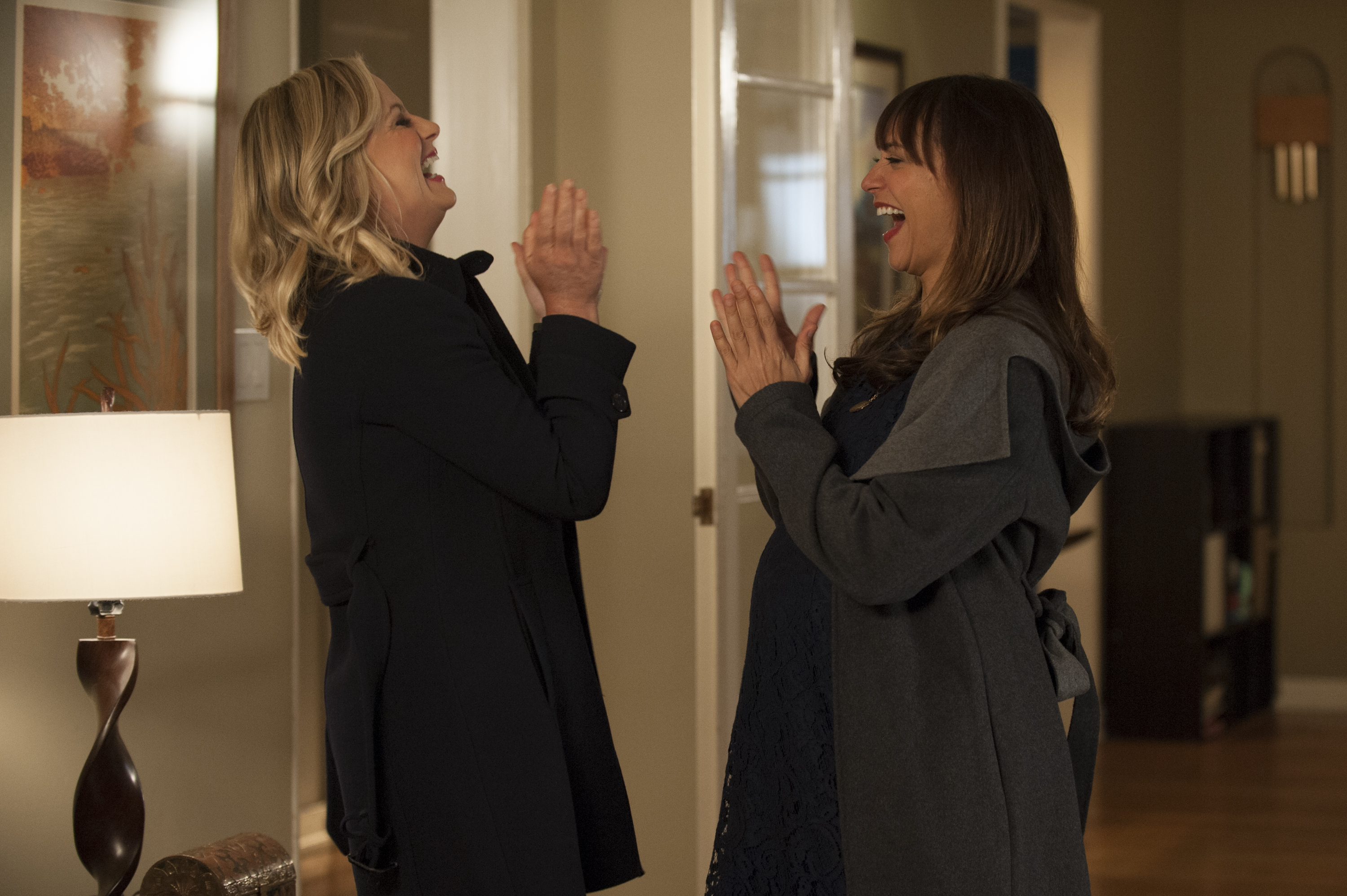 Parks and Recreation - Leslie Knope and Ann Perkins laugh and clap hands