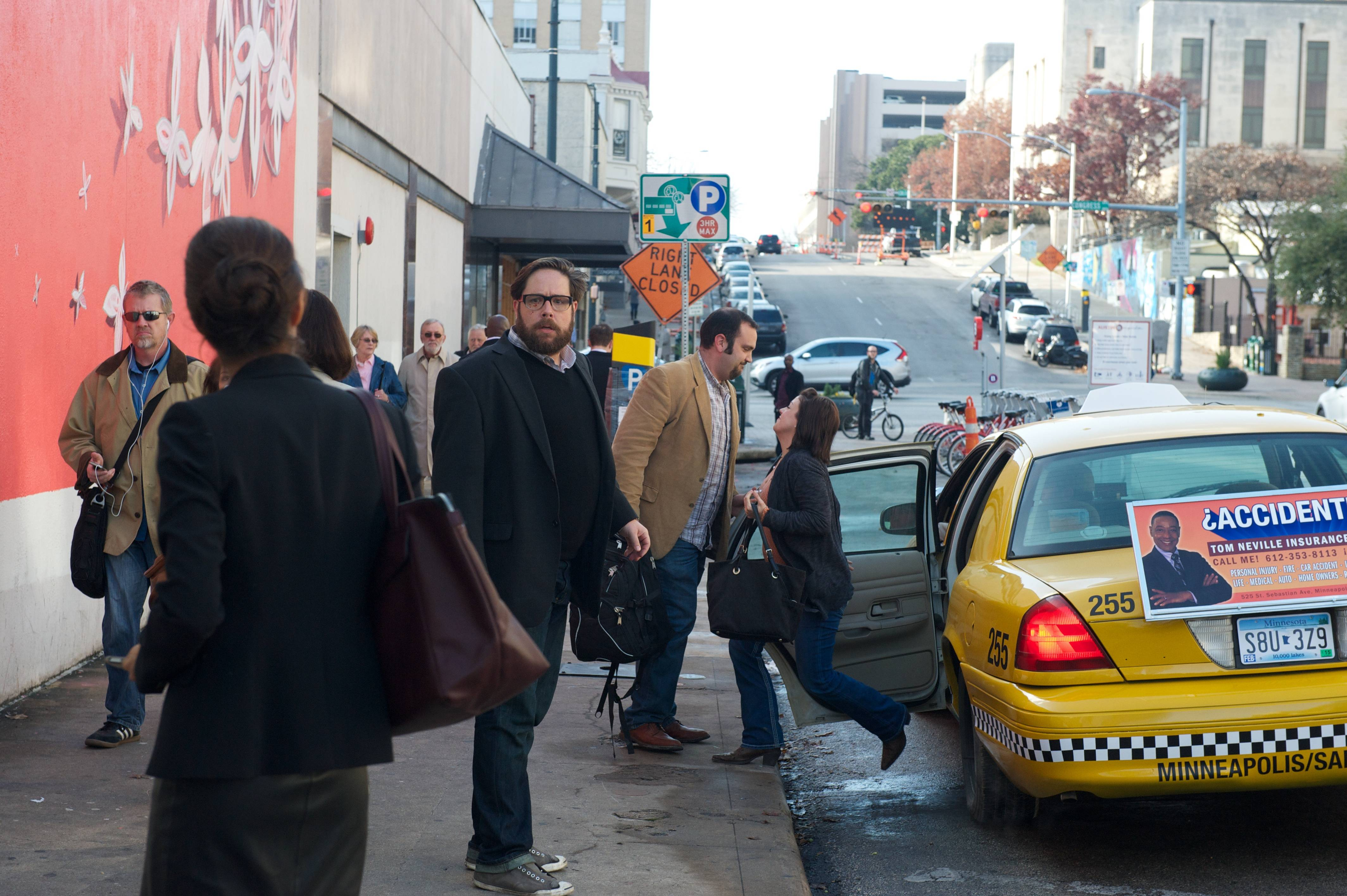 Revolution - Aaron Pittman stands bewildered on a vibrant city street with power