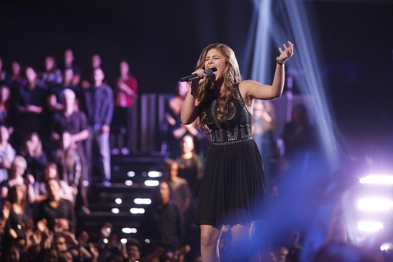 "Moving into the Top 12, the bubbly teenager showed a dark side with a heartbreaking take on U2's ""Love Is Blindness,"" earning a standing ovation from her coach Christina and a ticket to the Top 10."