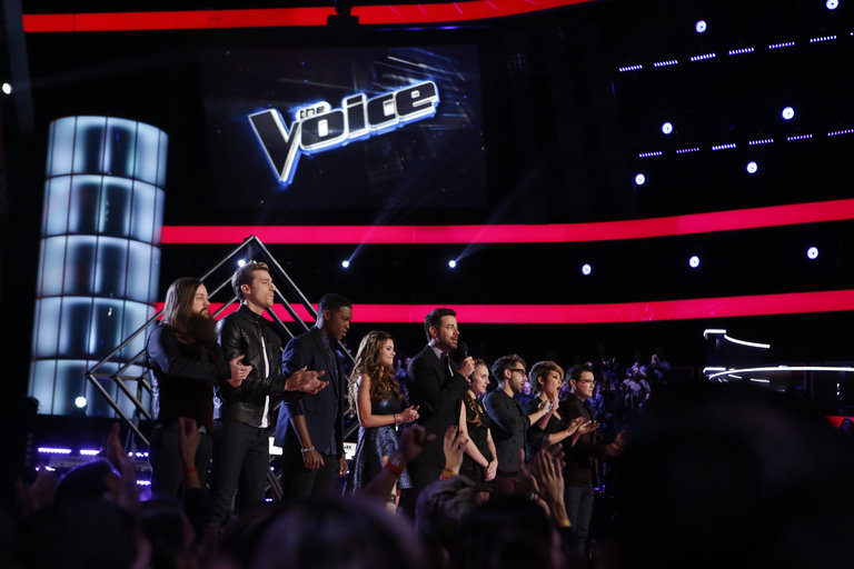 """THE VOICE -- """"Live Show"""" Episode 516B -- Pictured: (l-r) Cole Vosbury, Ray Boudreaux, Matthew Schuler, Jacquie Lee, Carson Daly, Caroline Pennell, Will Champlin, Tessanne Chin, James Wolpert -- (Photo by: Trae Patton/NBC)"""