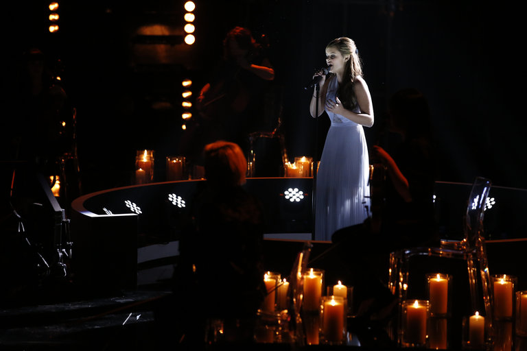 "Then it was on to the semifinals, where Jacquie, clad in an evening gown and shimmering in candlelight, gave a dramatic and powerful take on Sarah McLachlan's ""Angel,"" punching her ticket to the finals."