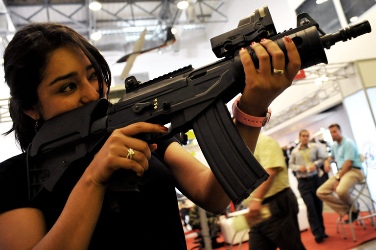 A woman holds a new battle rifle Galil A