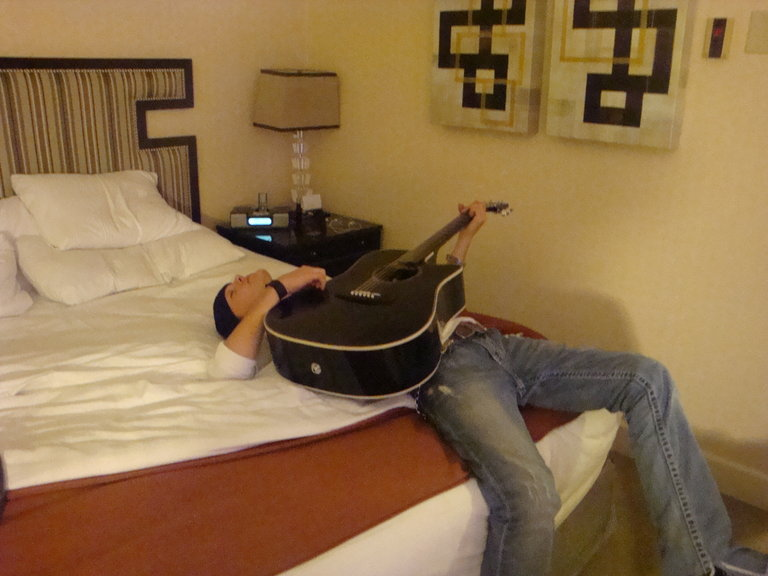 Just like a country boy...... crashed with his guitar in hand!