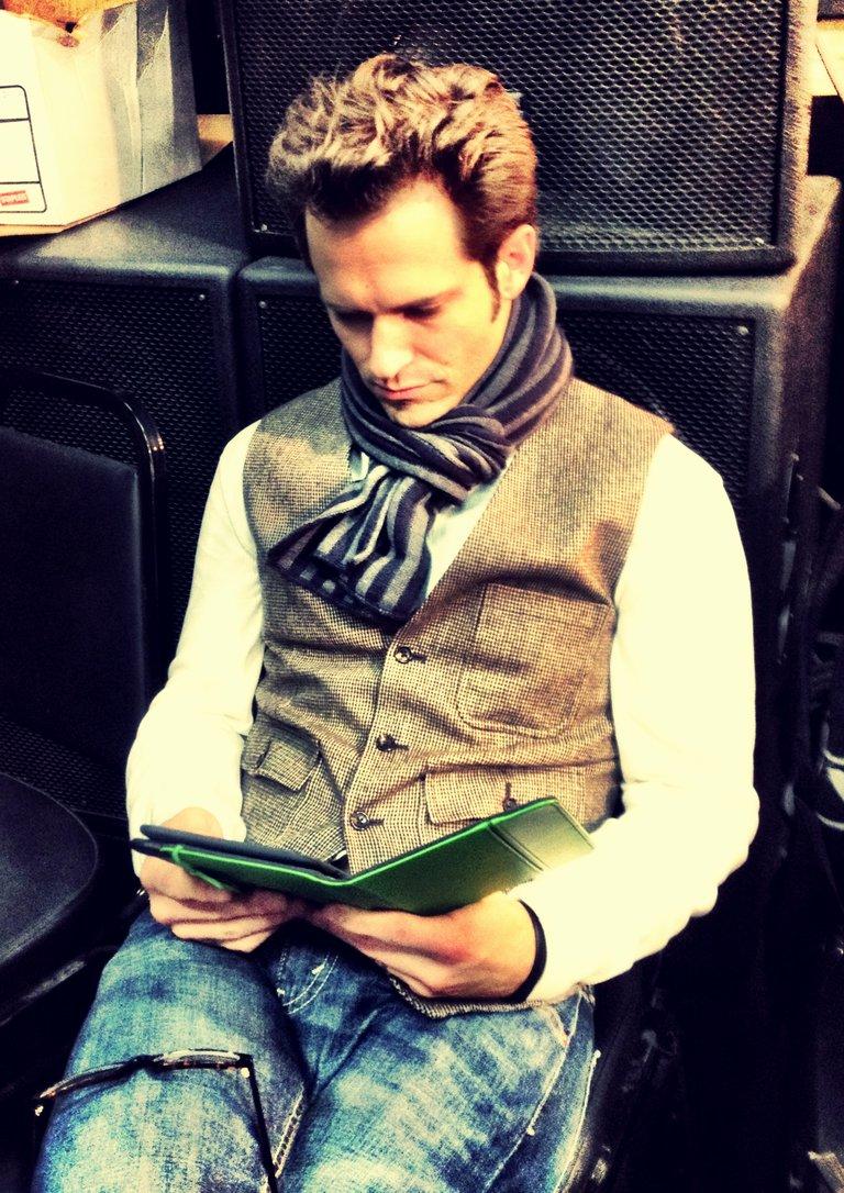 Tony reading in the corner.