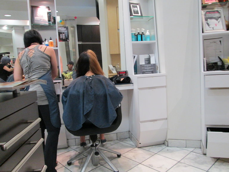 getting my hair touched up in the salon