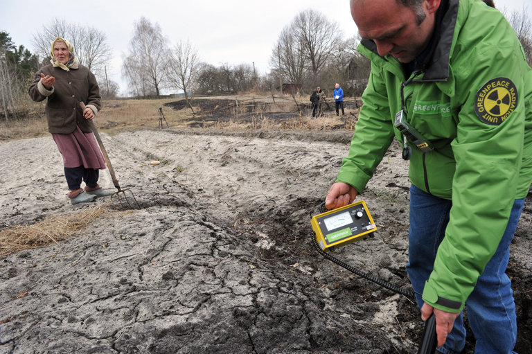 A Greenpeace member measures radioactivi