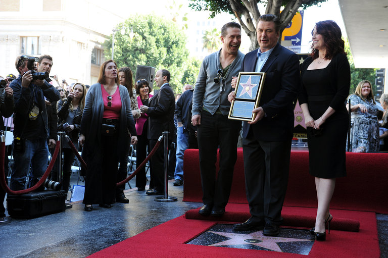 Actor Alec Baldwin (C) poses with his br