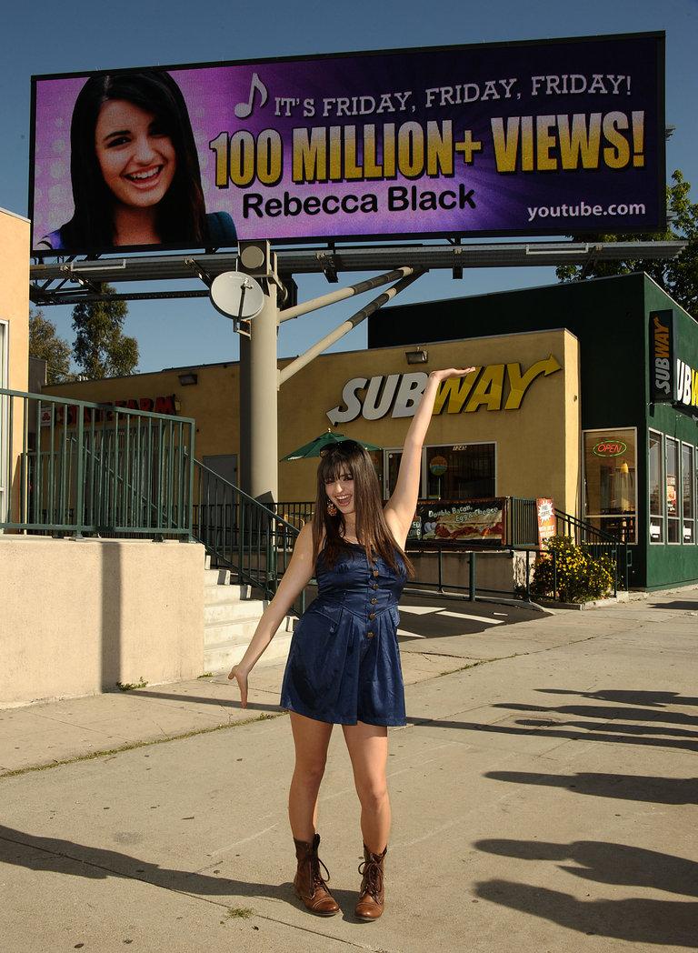 Internet Sensation Rebecca Black Unveils Digital Billboard Celebrating Her 100 Million Views On YouTube