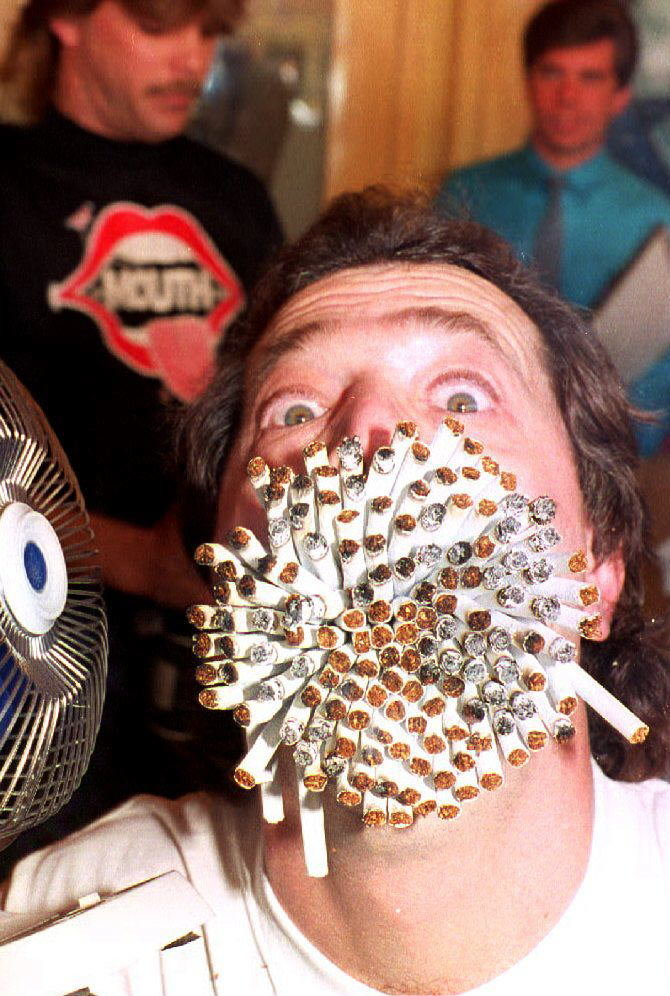 Jim Mouth, of Whittier, California, uses a fan to