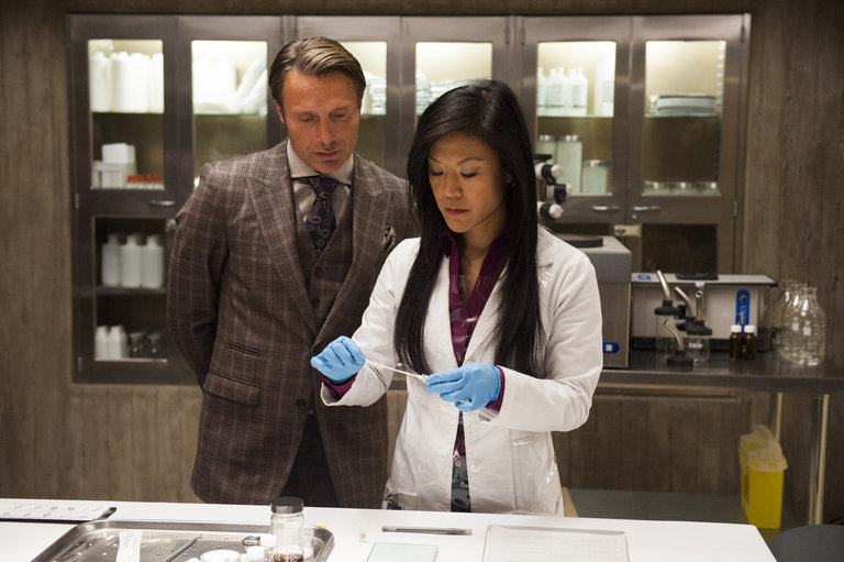 "HANNIBAL -- ""Kaiseki"" Episode 201 -- Pictured: (l-r) Mads Mikkelsen as Dr. Hannibal Lecter, Hettienne Park as Beverly Katz -- (Photo by: Brooke Palmer/NBC/NBCU Photo Bank)"