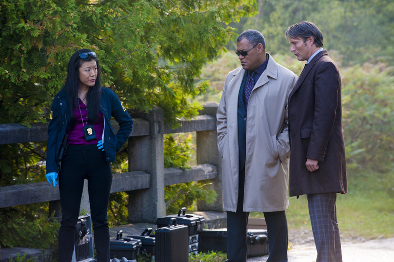 "HANNIBAL -- ""Kaiseki"" Episode 201 -- Pictured: (l-r) Hettienne Park as Beverly Katz, Laurence Fishburne as Jack Crawford, Mads Mikkelsen as Dr. Hannibal Lecter -- (Photo by: Brooke Palmer/NBC/NBCU Photo Bank)"