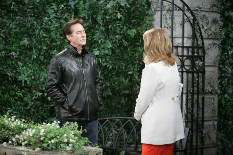 Marlena blasts John, then seeks solace in Roman's arms.