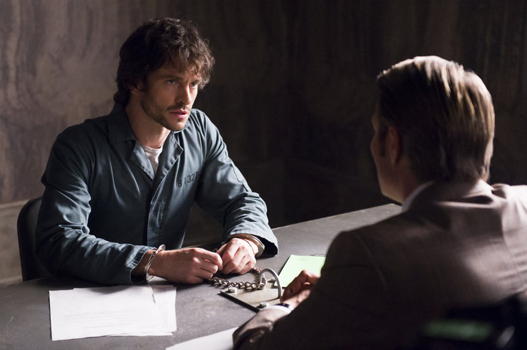 "HANNIBAL -- ""Hassun"" Episode 203 -- Pictured: (l-r) Hugh Dancy as Will Graham, Mads Mikkelsen as Hannibal Lecter -- (Photo by: Brooke Palmer/NBC)"