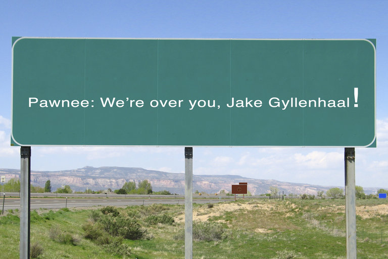 Parks and Recreation - Town Slogan - Pawnee: We're over you, Jake Gyllenhaal!