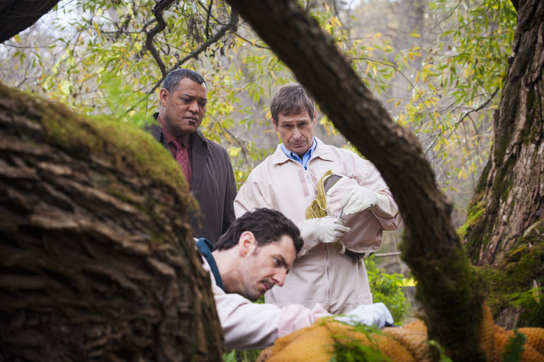 "HANNIBAL -- ""Takiawase"" Episode 204 -- Pictured: (l-r) Laurence Fishburne as Jack Crawford, Aaron Abrams as Brian Zeller, Scott Thompson as Jimmy Price  -- (Photo by: Brooke Palmer/NBC)"