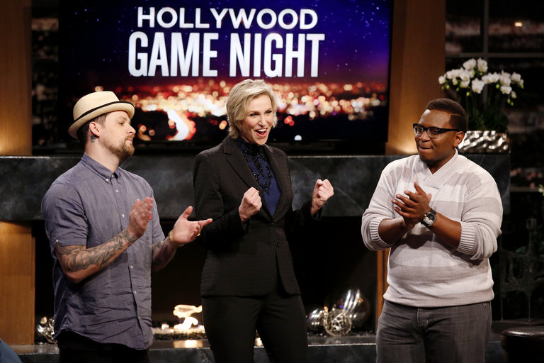 HOLLYWOOD GAME NIGHT -- Episode 206 -- Pictured: (l-r) Joel Madden, Jane Lynch, Contestant -- (Photo by: Trae Patton/NBC)