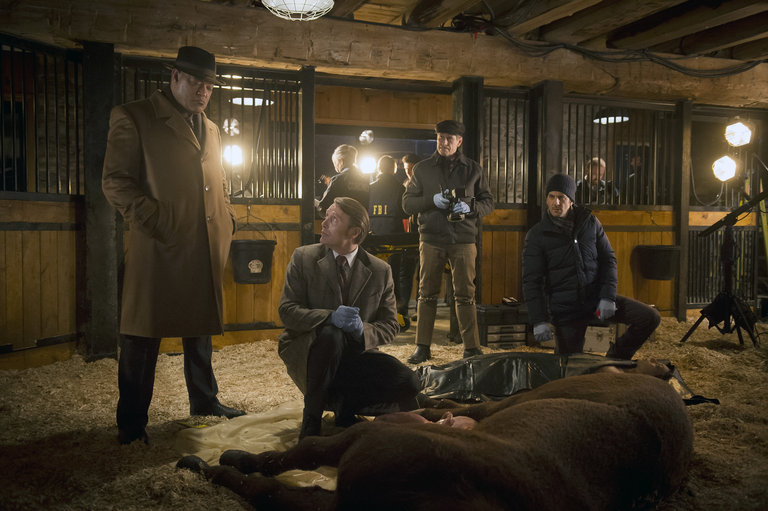 """HANNIBAL -- """"Su-zakana"""" Episode 208 -- Pictured: (l-r) Laurence Fishburne as Jack Crawford, Mads Mikkelsen as Hannibal Lecter, Scott Thompson as Jimmy Price, Aaron Abrams as Brian Zeller -- (Photo by: Brooke Palmer/NBC)"""