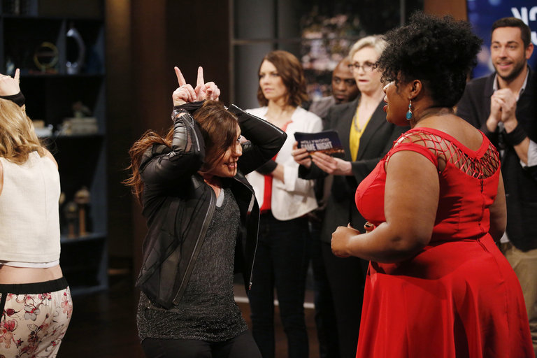 "HOLLYWOOD GAME NIGHT -- ""50 Charades of Grey"" -- Pictured: (l-r) Rachael Ray, Contestant -- (Photo by: Trae Patton/NBC)"