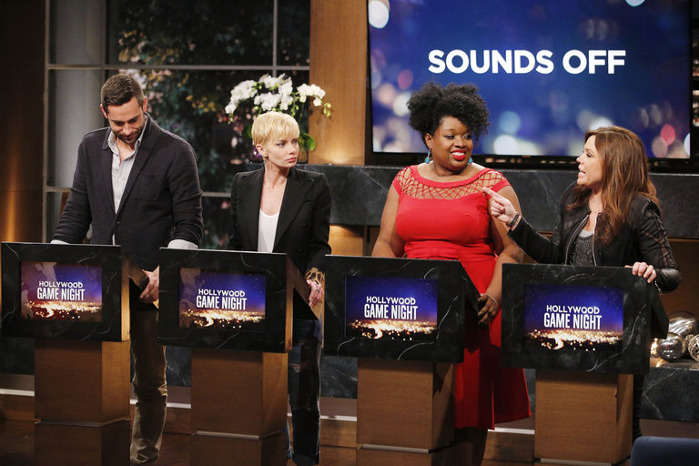 """HOLLYWOOD GAME NIGHT -- """"50 Charades of Grey"""" -- Pictured: (l-r) Zachary Levi, Jaimie Pressly, Contestant, Rachael Ray -- (Photo by: Trae Patton/NBC)"""