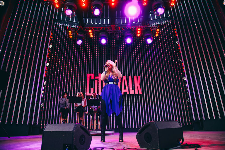 """THE VOICE -- Pictured:  Dani Moz performs at the top 12 artists of NBC's Emmy award winning hit """"The Voice"""" at City Walk in Universal City, CA.  """"The Voice"""" live shows continue on Monday, April 21st at 8 p.m. ET -- (Photo by: Ryan Tuttle/NBC)"""