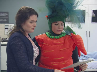 Girl dressed up as carrot