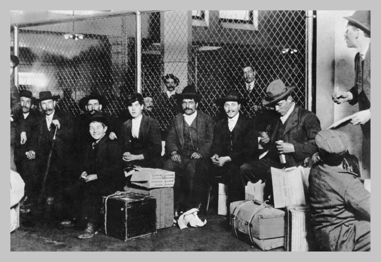 Immigrant Men Sitting at Ellis Island