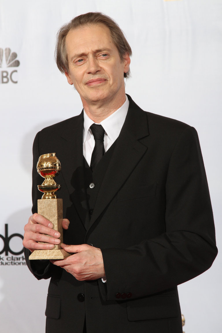 Actor Steve Buscemi poses with his award