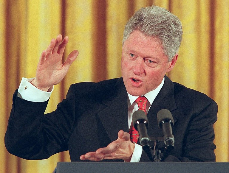 US President Bill Clinton speaks to a conference o