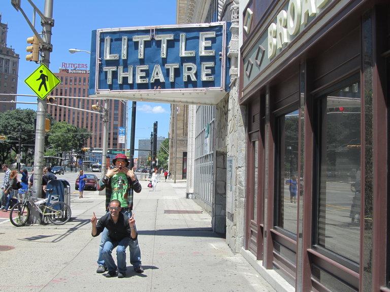Jarrett, Raja below a small theatre
