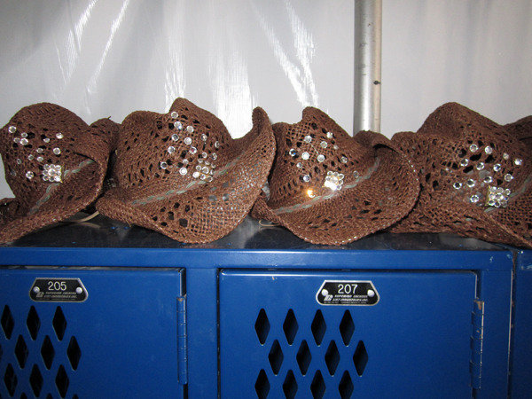 We rhinestoned our own hats! :)