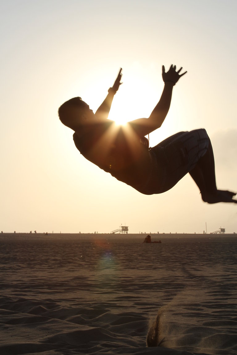 Sebastian hugging the sun in the middle of a back flip!