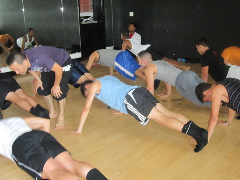 The Boys, doing a few push ups.