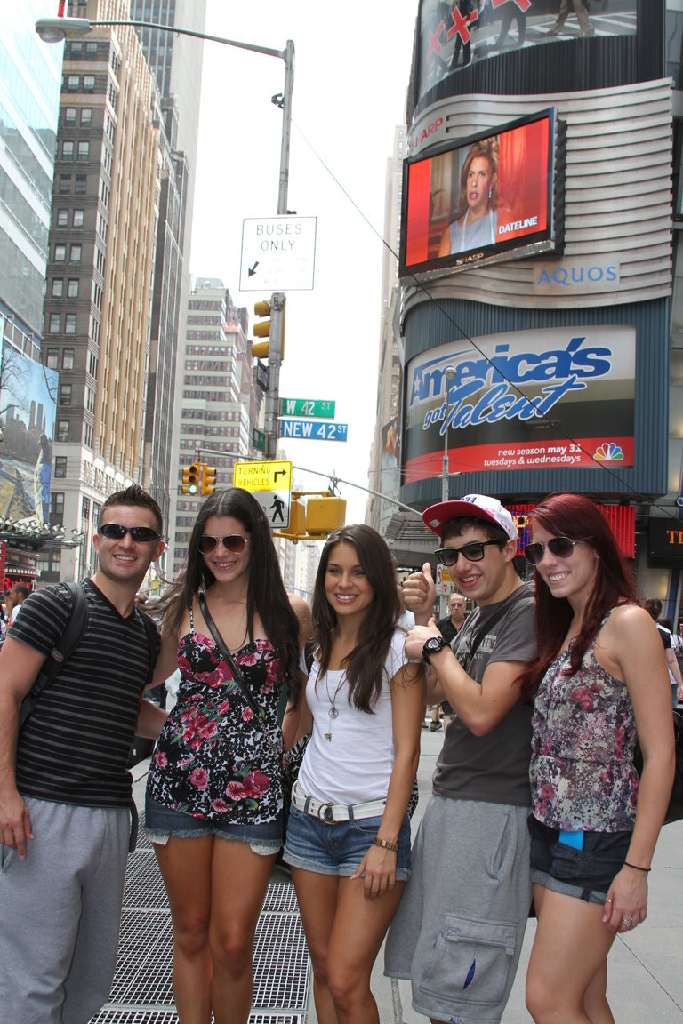 Haha! Some of the All Stars Took a Picture Infront of a America's Got Talent Billboard!