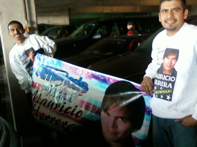 "MAURICIO'S ""Brothers""Junior and Hugo Holding up their Banner!"