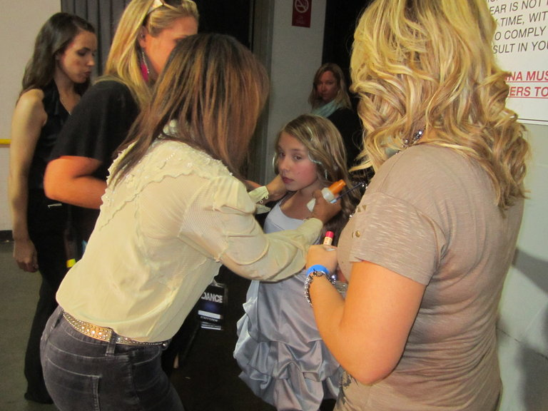 last minute touches before going on stage