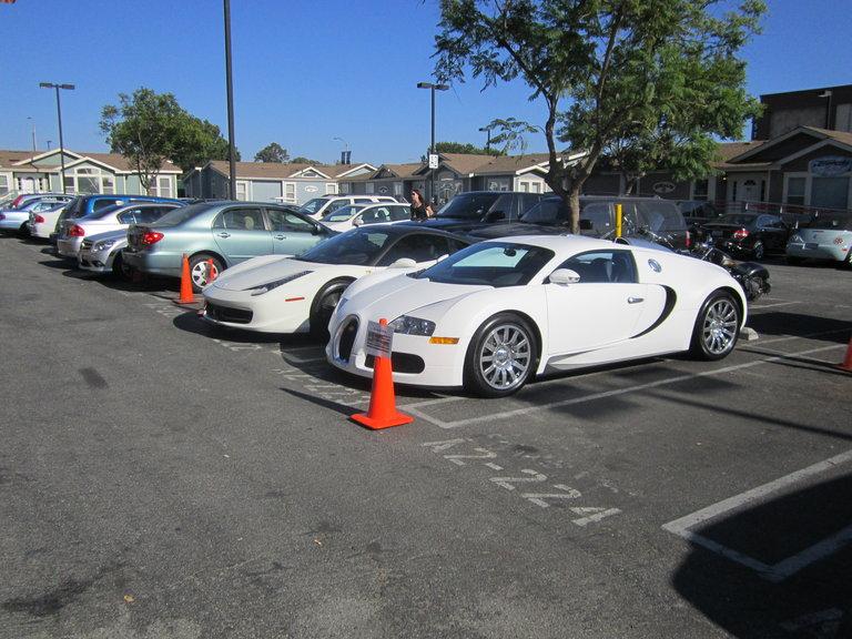fancy fancy cars in the parking lot