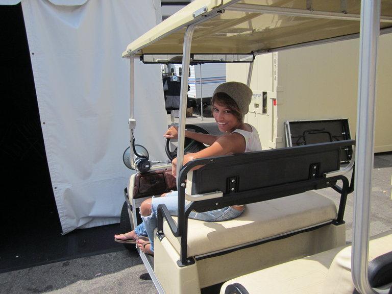 on a golf cart Backstage! lol