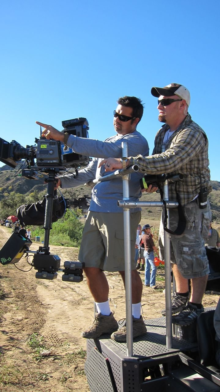 """""""B"""" Camera operator Victor Macias and his focus puller Kyle Jewell watch the rehearsal and discuss camera movements."""