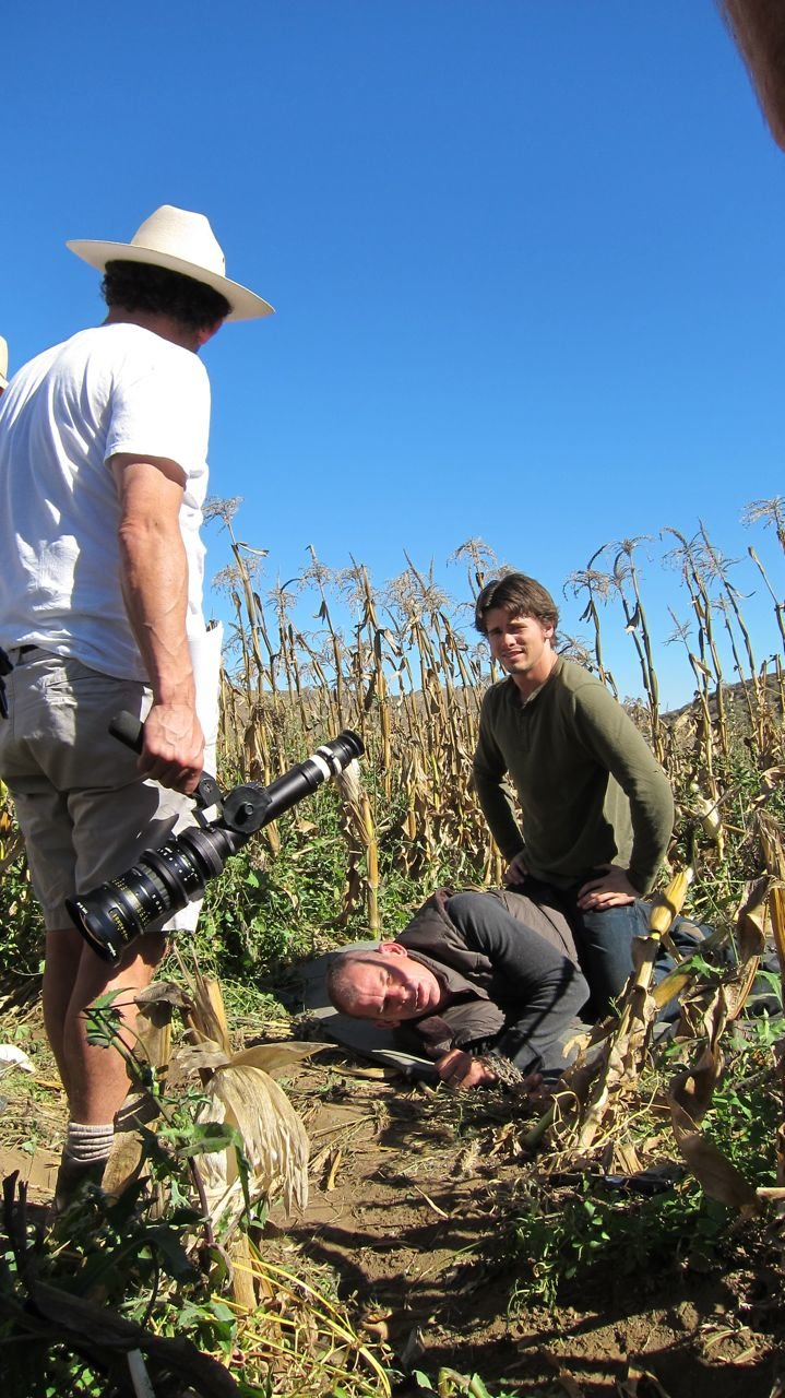 Director Jeffrey Reiner (hat) looks for the best camera placement as Jason Ritter and Peter Murnik wait for direction.