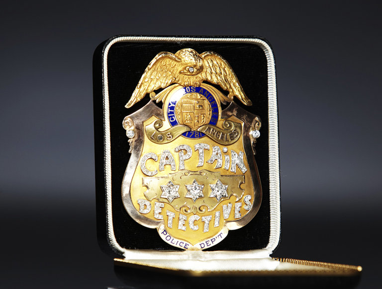 Solid-Gold Police Badge
