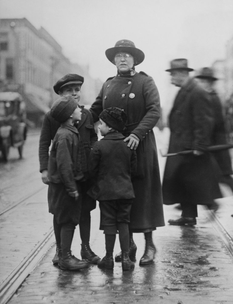 Policewoman Protecting Children Against Traffic Dangers In New York