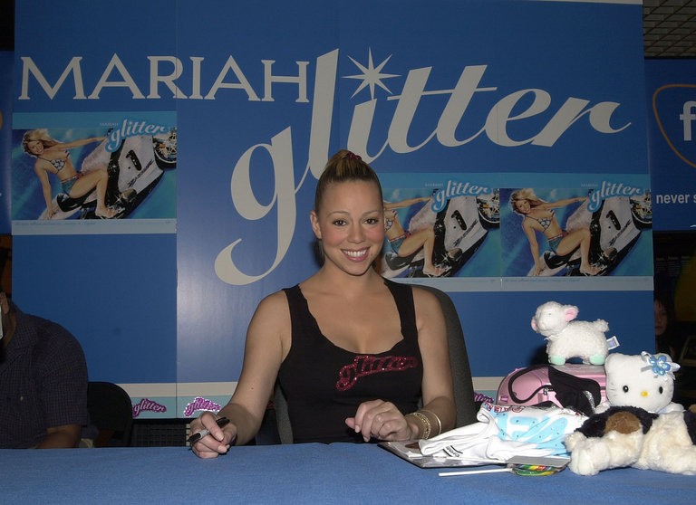 "Mariah Carey signing her ""Loverboy"" single from her upcoming album ""Glitter"" on Virgin records"