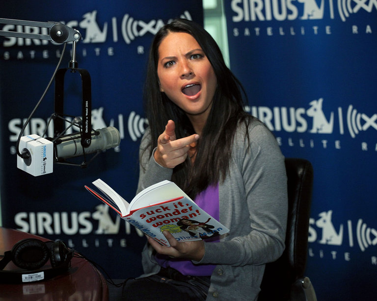 Delivering a dramatic reading from her book at the Sirius XM Studio.