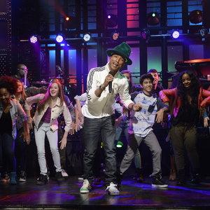 "Pharrell Williams performs ""Happy"" on Saturday Night Live on April 5, 2014."