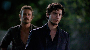 "Revolution - still from ""Mis Dos Padres,"" Episode 211, of Sebastian Monroe following his son Conner"
