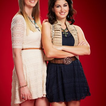 "THE VOICE -- Season: 6 -- Pictured: (l-r) Madison Metcalf, Alaska Holloway as ""Alaska & Madi"" -- (Photo by: Paul Drinkwater/NBC)"