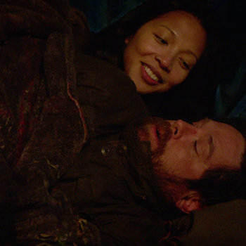 Revolution - Priscilla warms herself with Aaron Pittman by a campfire