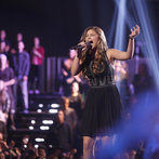 """Moving into the Top 12, the bubbly teenager showed a dark side with a heartbreaking take on U2's """"Love Is Blindness,"""" earning a standing ovation from her coach Christina and a ticket to the Top 10."""
