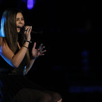 """Not content to play it safe, Jacquie next took on a stripped-down version of the dance music hit """"Clarity"""" by Zedd. The tiny teen with the big voice blew America away by turning the song into a soulful piano ballad, and moved on to the next round."""